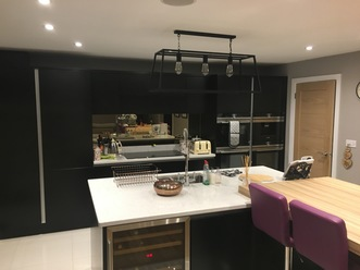 Matt Black handle free kitchen