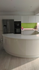 White High gloss curved kitchen